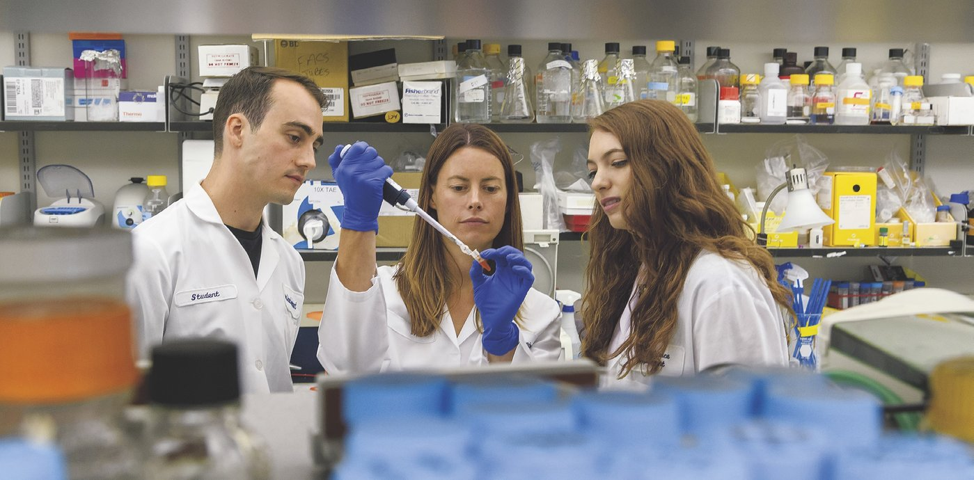 Blythe Shepard (center) and her research team, including Ryan Kurtz and Lily Steinberg (C'20), focus on the role of microscopic olfactory receptors in metabolic diseases.