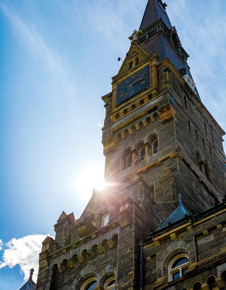 healy hall with sun