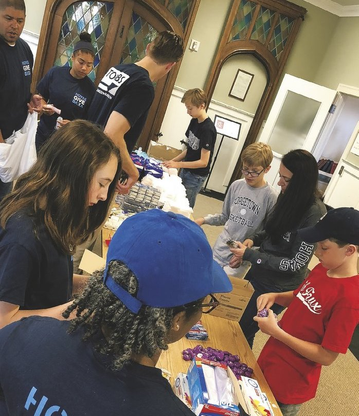 Club of Atlanta: assembled personal hygiene kits for homeless teens outreach.