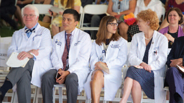 medical faculty sitting in a row