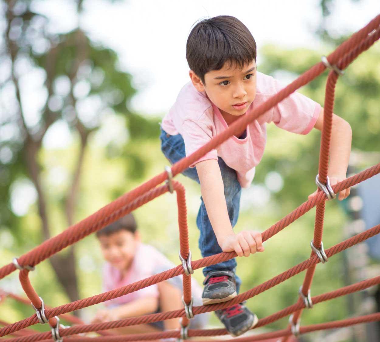 kid climbing on jungle gym