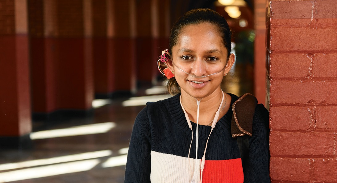 Shavini Fernando (G'18) wears a first-level prototype of OxiWear, her invention to alert users with pulmonary hypertension when their oxygen levels drop critically low. Fernando has the condition herself.