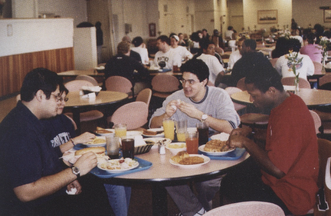 Students in the 7=90s eating food together
