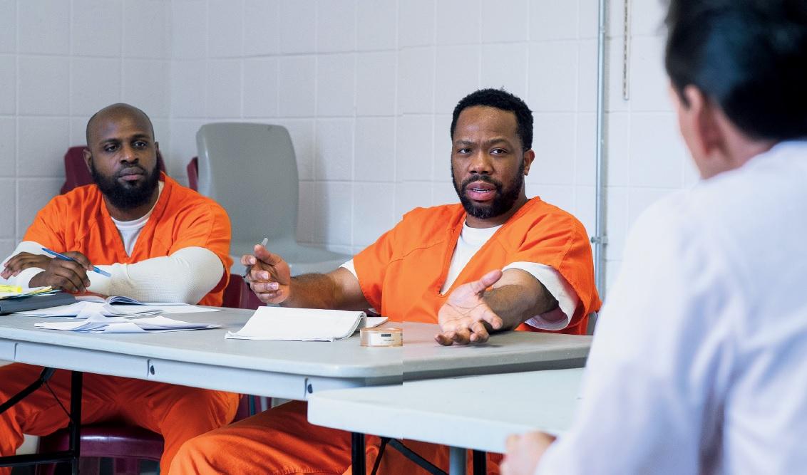 prisoner talking in seminar room