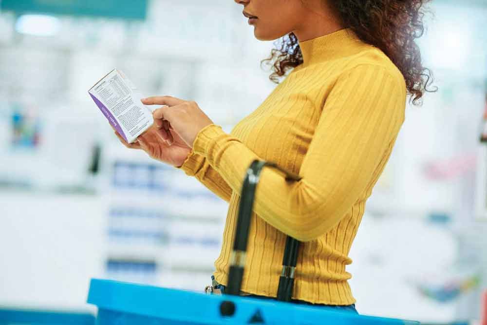 woman looking at label