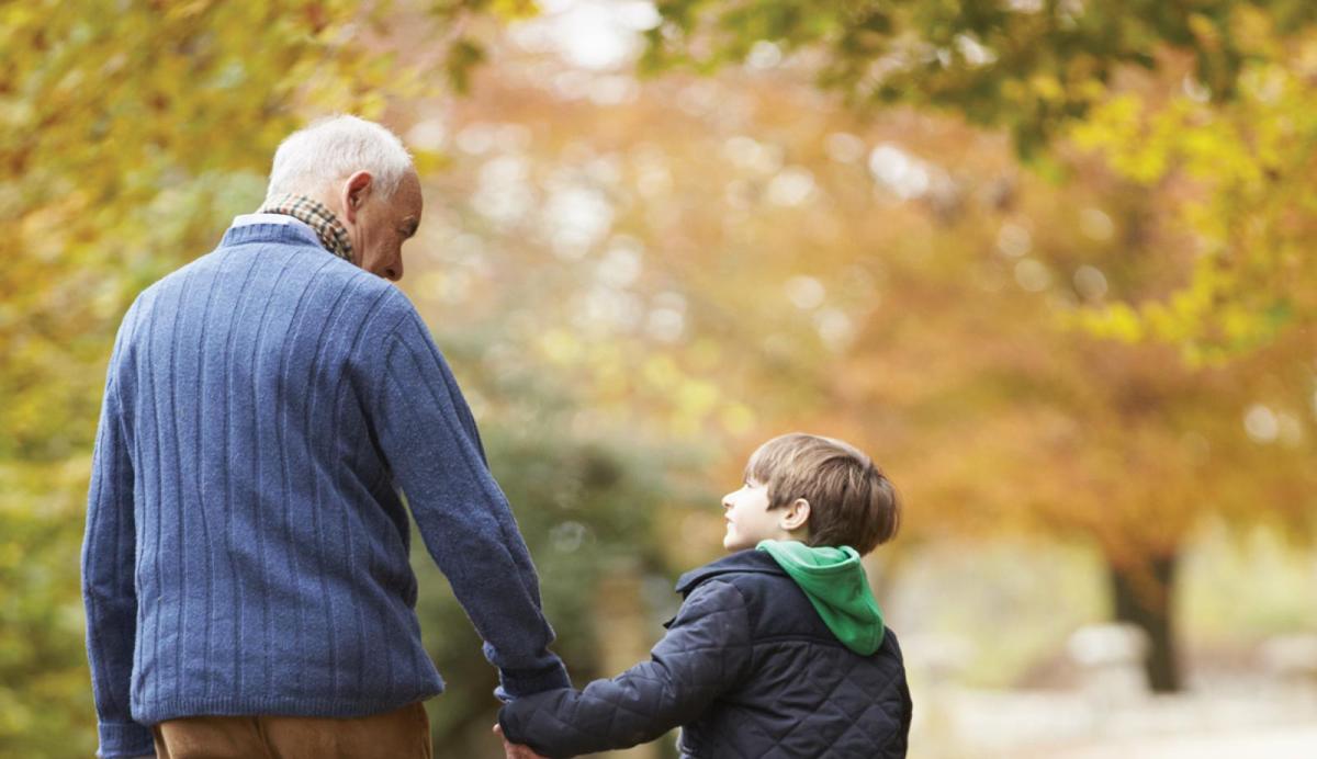grandpa and grandson walking