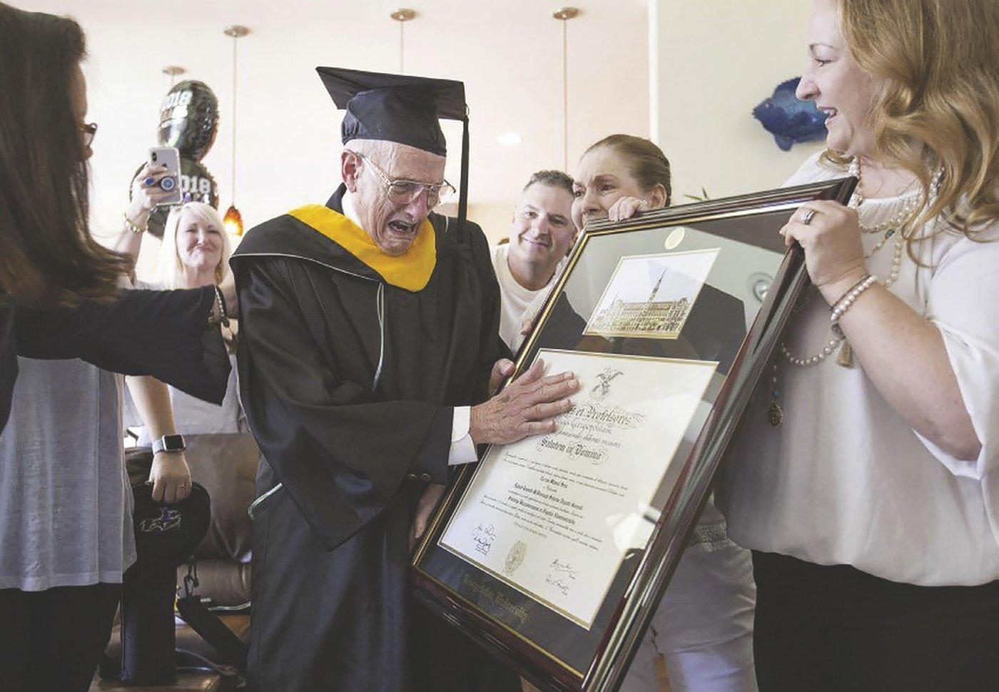 Carlos Manuel Sera with diploma