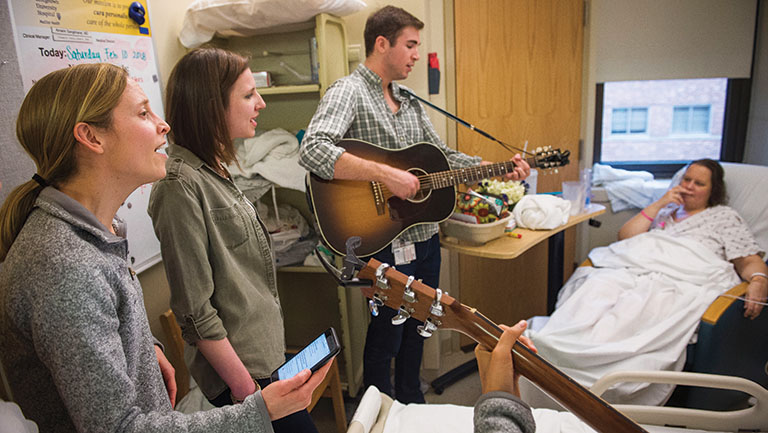 medical students singing for patient