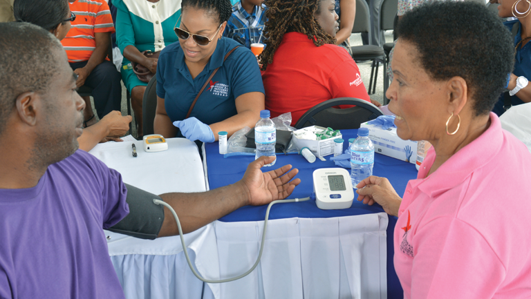 nurses monitoring people's blood pressure