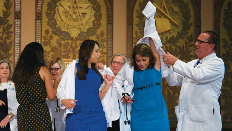 people putting on white coats