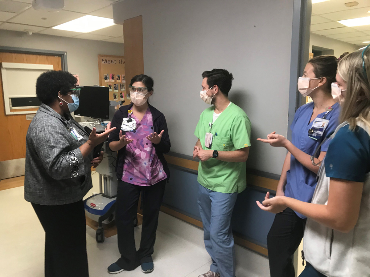 Rev. Taylor meets with the nursing team