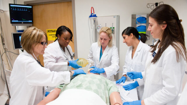 nurses working on dummy
