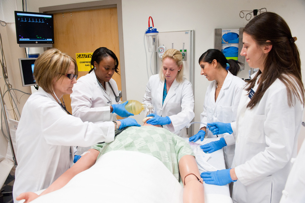 nurses working on dummy