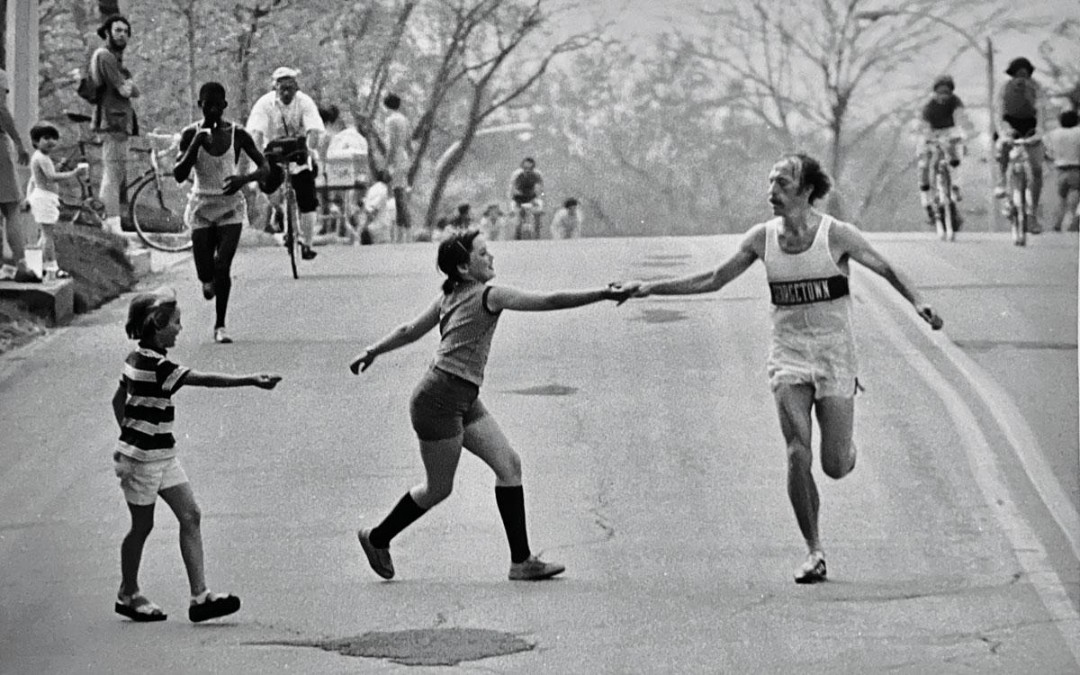 Jack Fultz at Boston Marathon being handed water