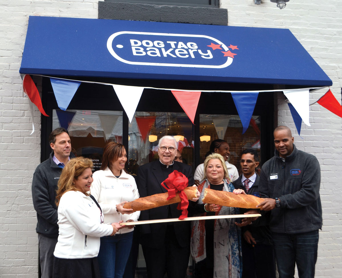father curry in front of the bakery