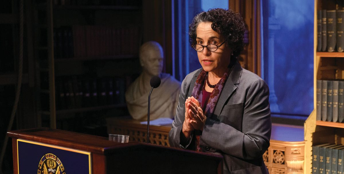 maria cancian speaking at podium